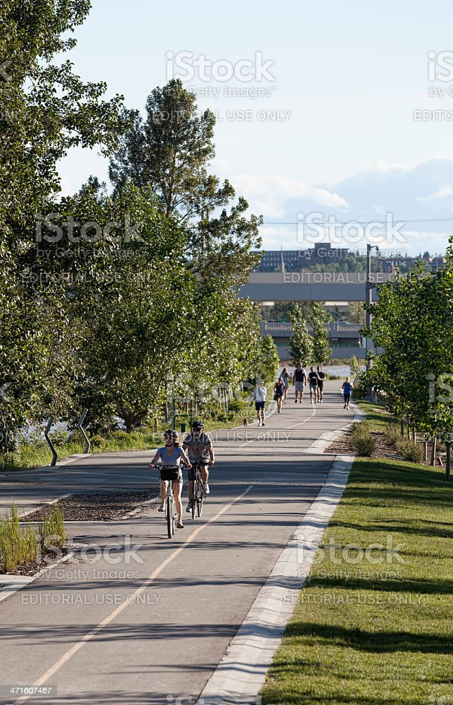 Calgarians resuming daily activities along the Bow River royalty-free stock photo