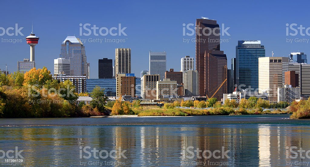 Calgary Skyline in Fall With Reflection in Bow River stock photo
