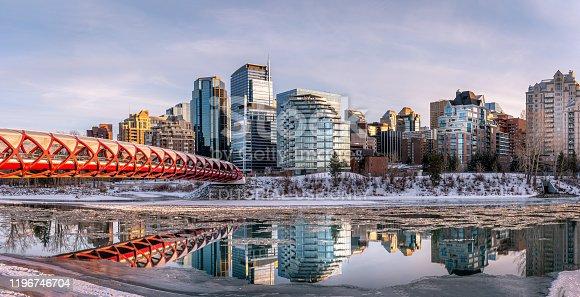 Calgary, Alberta - December 29, 2019: View of Calgary's skyline along the Peace Bridge on a beautiful winter evening.
