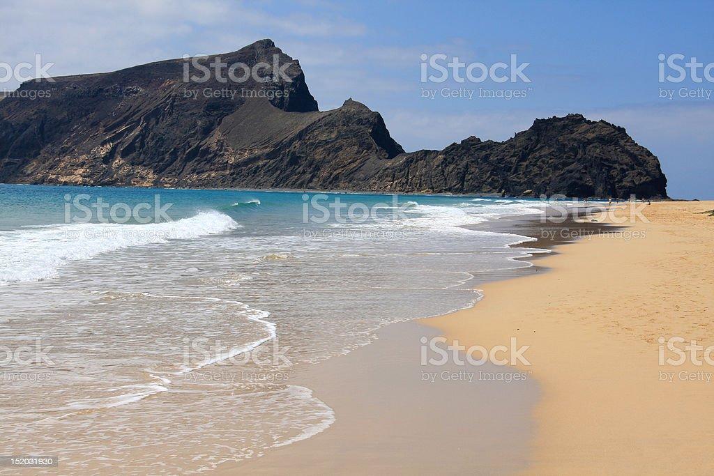 Calheta beach and Ilheu de Baixo island stock photo