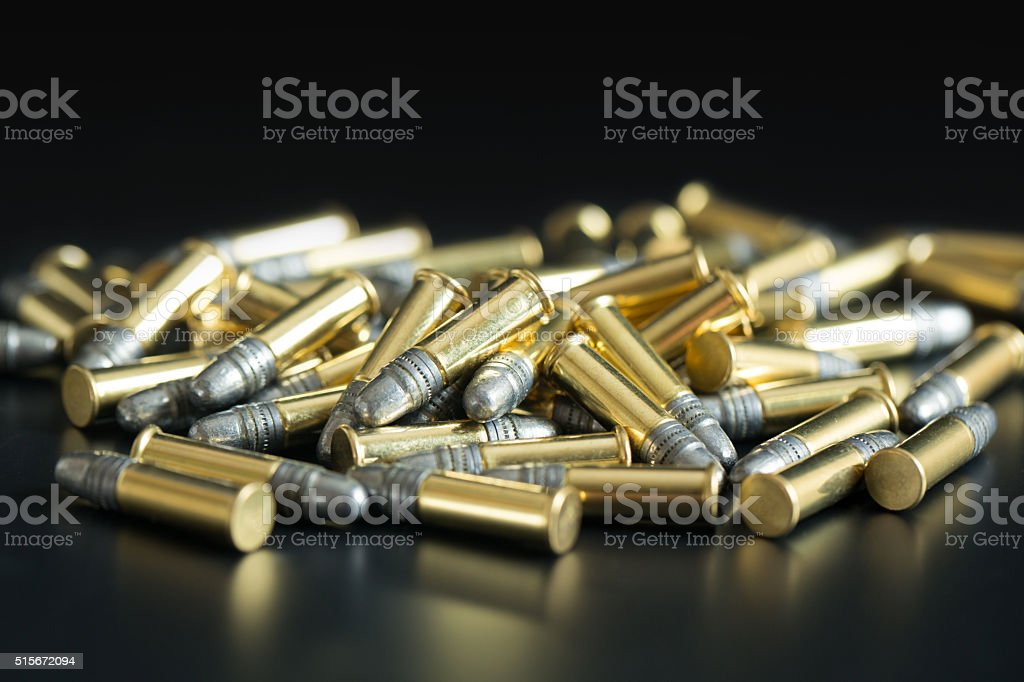 .22 Caliber Bullets on Black Background stock photo