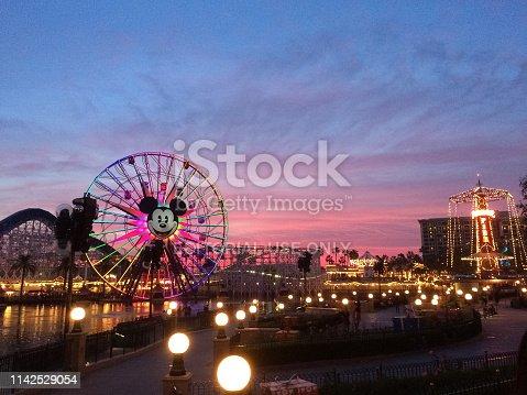 Anahiem, California, USA - December 21, 2014: Tourists wander around Disney's California Adventure at dusk. California Adventure is a park located adjacent to Disneyland, a major tourist attraction in Anaheim.