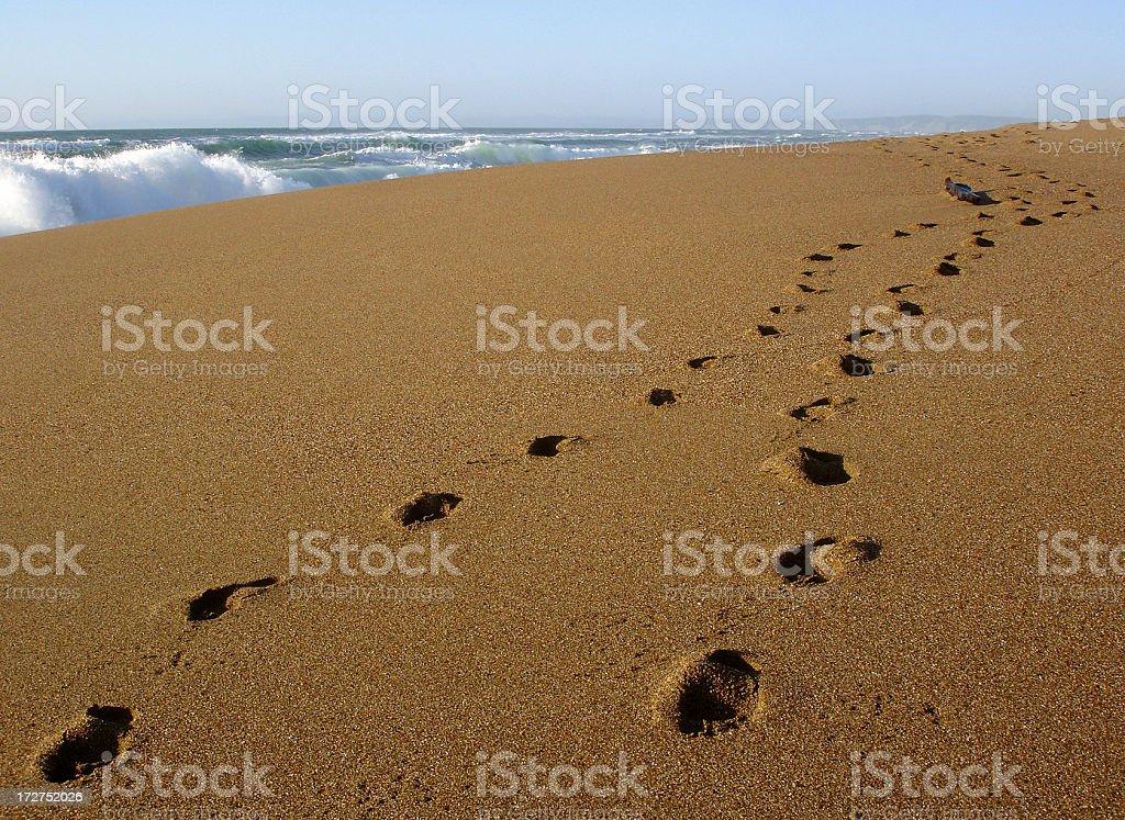 California beach footsteps stock photo