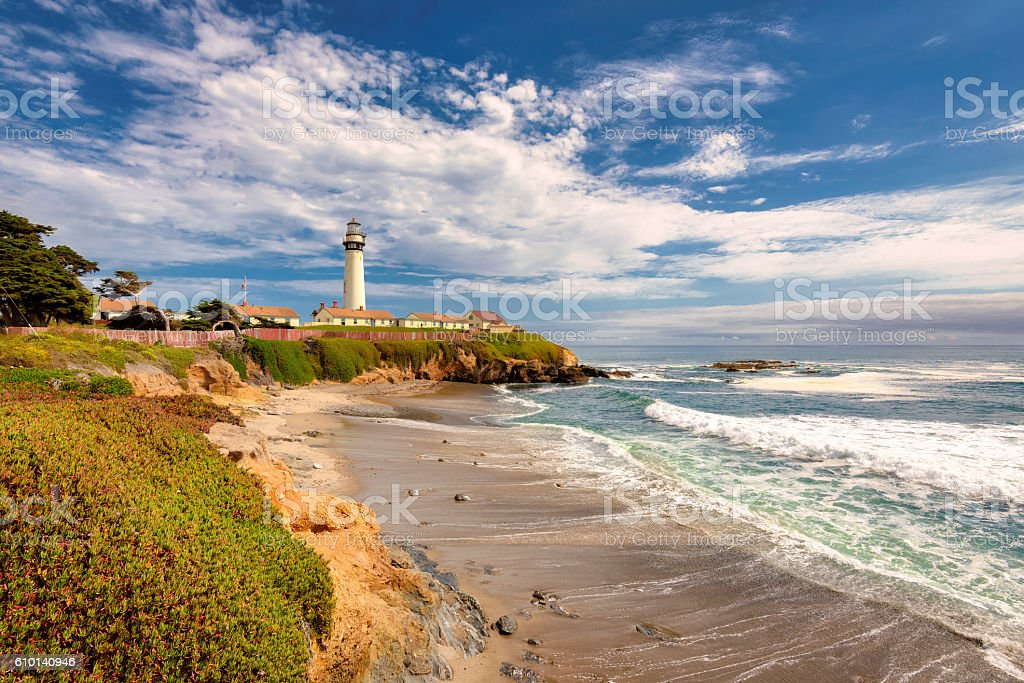 California beach with lighthouse stock photo