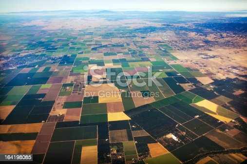 Agricultural fields in Central Valley, California.  Mountain range visible in far distance.