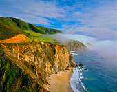 THE BIG SUR COAST OF CALIFORNIA'S PACIFIC COAST HIGHWAY  HOUVERS OVER THE FOG FILLED PACIFIC OCEAN SOUTH OF CARMEL-BY-THE-SEA, CALIFORNIA