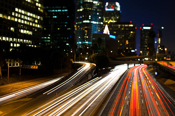 California Freeway at Night with Car Lights stock photo