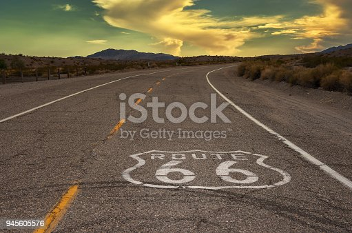Route 66 logo on road that leads into sunset