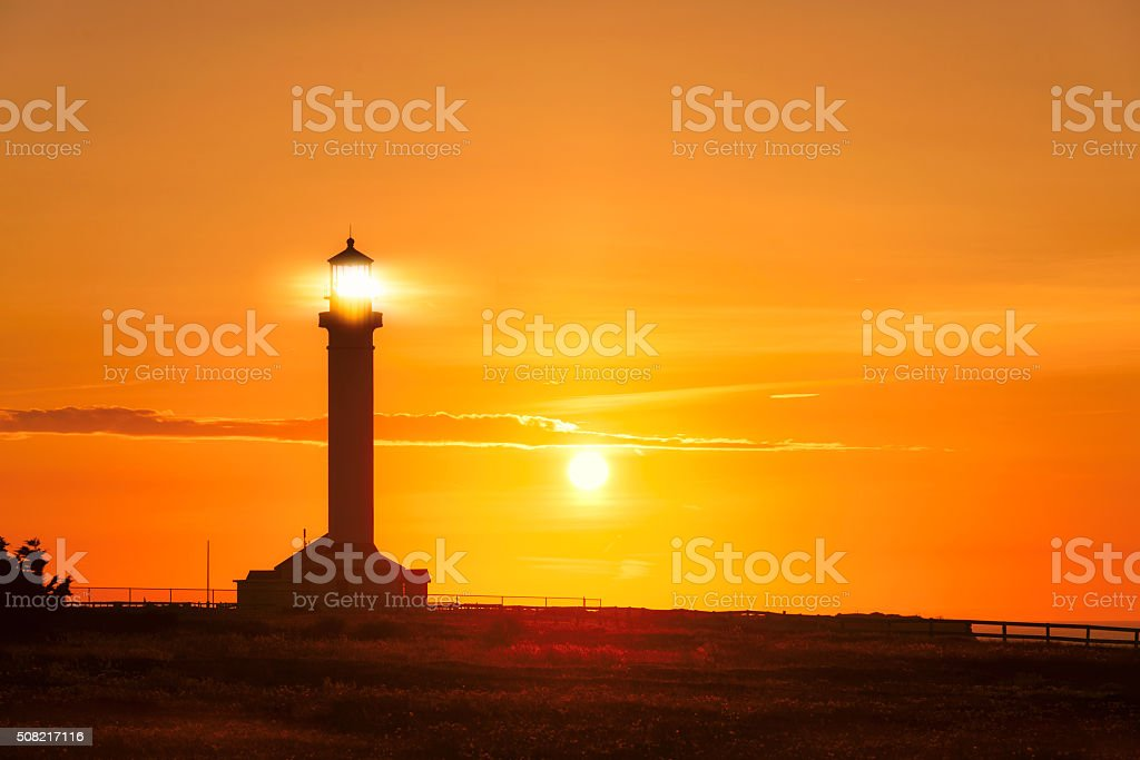 California Lighthouse searchlight beam at sunset stock photo