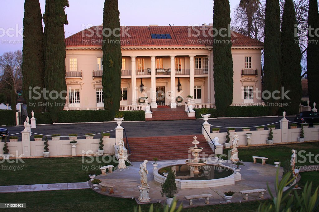 California Mansion and fountain at sunset stock photo