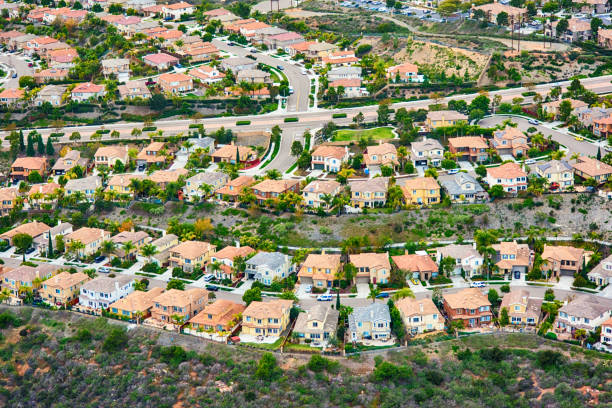 California Planned Residential Community An aerial view of a generic planned residential community in Southern California.  This image was shot over Carlsbad, California during a photo flight of the region. urban sprawl stock pictures, royalty-free photos & images