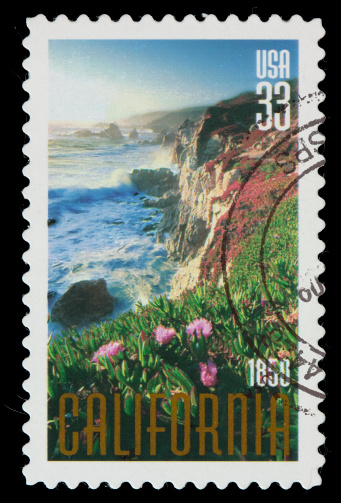 A United States postage stamp with an illustration of the California coastline.  DSLR with macro lens; no sharpening.