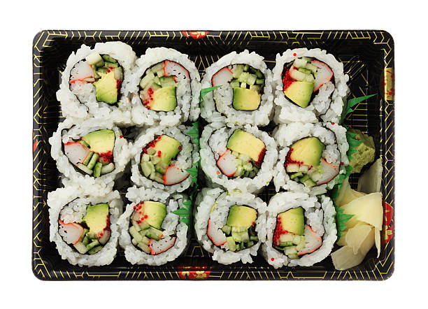 California rolls  sushi tray isolated on white background top view stock photo