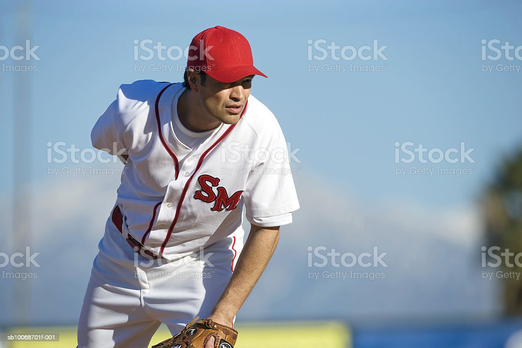 USA, California, San Bernardino, baseball pitcher preparing to throw, outdoors royalty-free stock photo