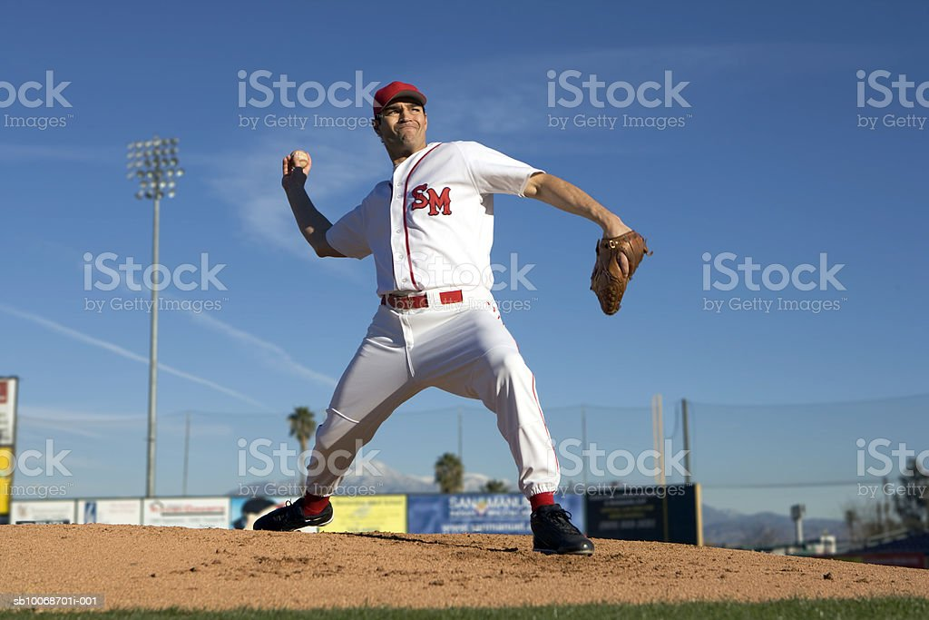 USA, California, San Bernardino, baseball pitcher throwing pitch, outdoors royalty-free stock photo