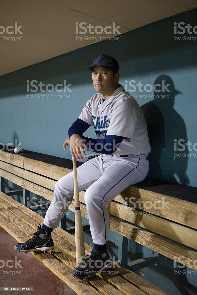 USA, California, San Bernardino, baseball player sitting in dugout, portrait royalty free stockfoto
