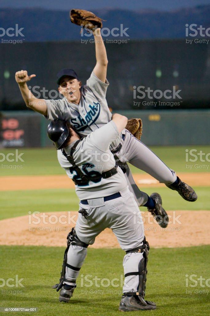 USA, California, San Bernardino, baseball players celebrating victory royalty-free stock photo