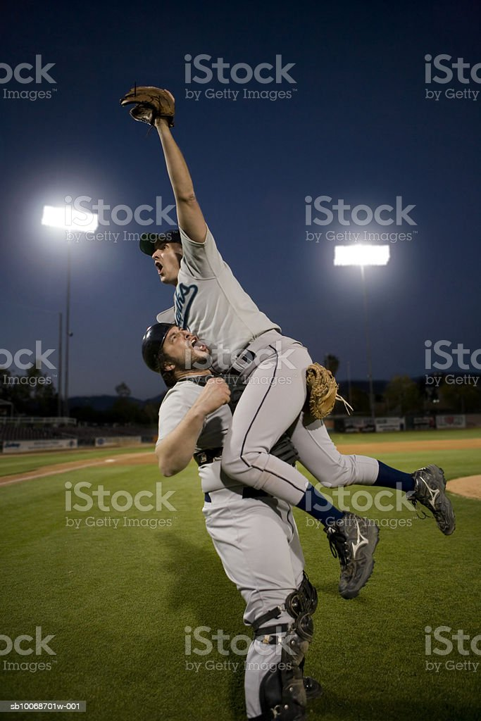 USA, California, San Bernardino, baseball players celebrating victory royalty-free stock photo