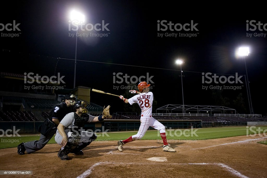 USA, California, San Bernardino, baseball players with batter swinging royalty-free stock photo