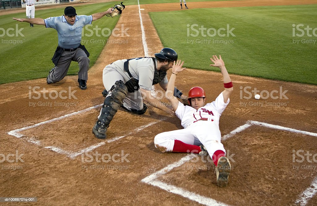 USA, California, San Bernardino, baseball runner sliding safely into home base royalty-free stock photo