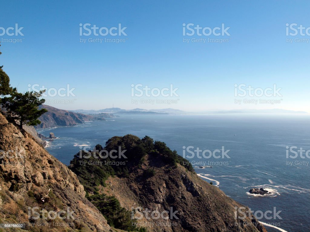 California scenic coastal cliffs with the city of San Francisco in the the far distant background stock photo