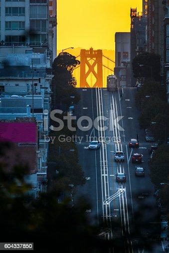 San Francisco, California street, vertical, sunrise, sunbeam, bay bridge.