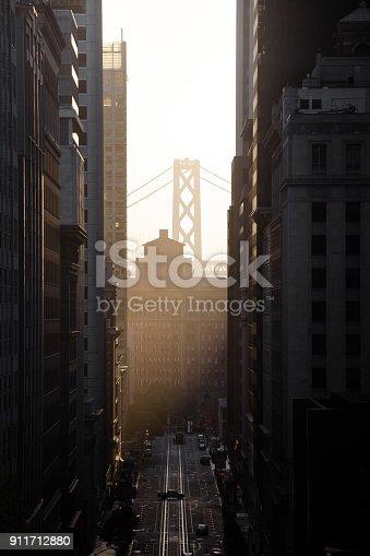 istock California Street with Oakland Bay Bridge at sunrise, San Francisco, California, USA 911712880