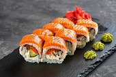 california sushi roll with salmon. Traditional Japaneese