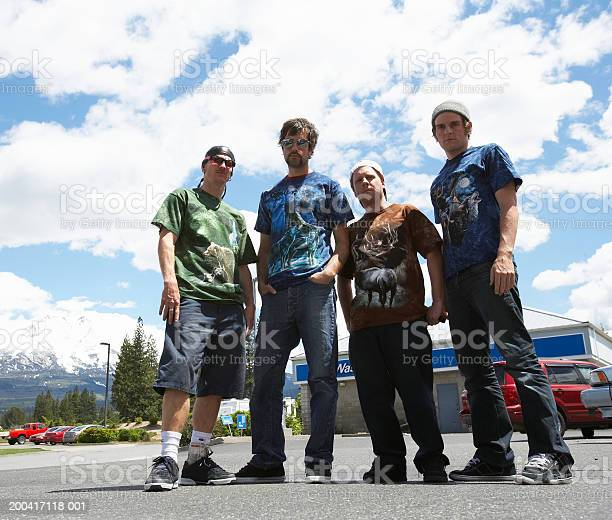 USA, California, Weed, four young men in parking lot at truck stop