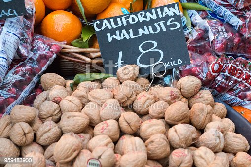 Californian Walnuts in Borough Market, London. There are brand signs visible in the background