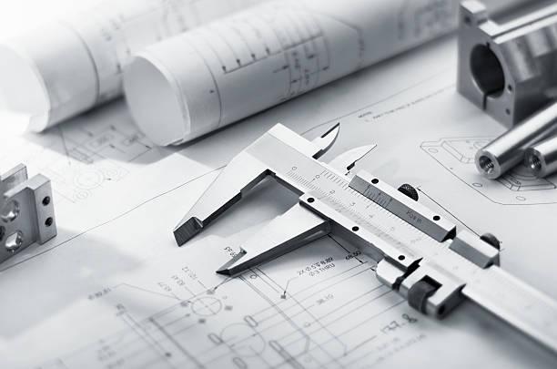 caliper on blueprint stock photo