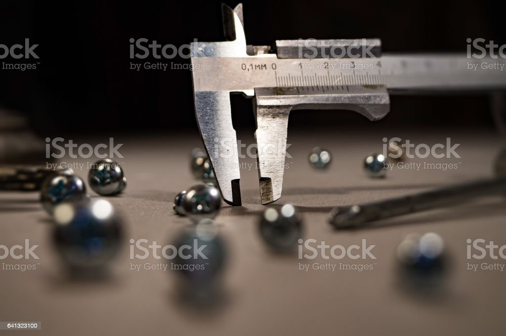 Calipers. Trammel and screws. Abstract composition. stock photo