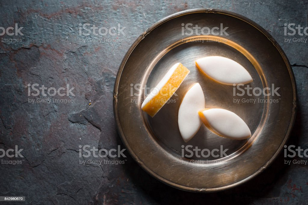 Calissons d'Aix-en-Provence on a plate on background. Traditional French Provence sweets. stock photo