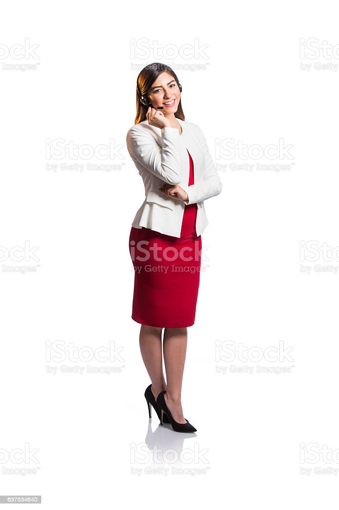 Call center agent standing and smiling at camera - foto de stock
