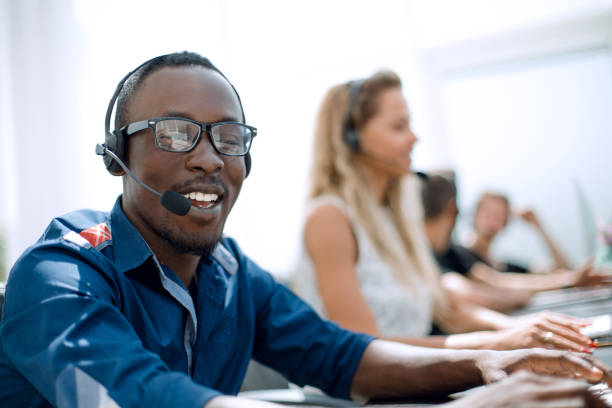 call center employee on the background of colleagues stock photo