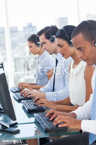 istock Call center employees sitting in line 849525332