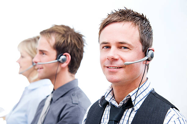 Call Center Employees Using Headsets Customer Service stock photo
