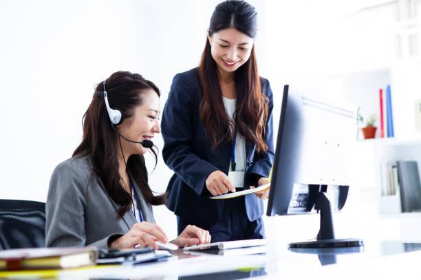 Call center female employees stock photo