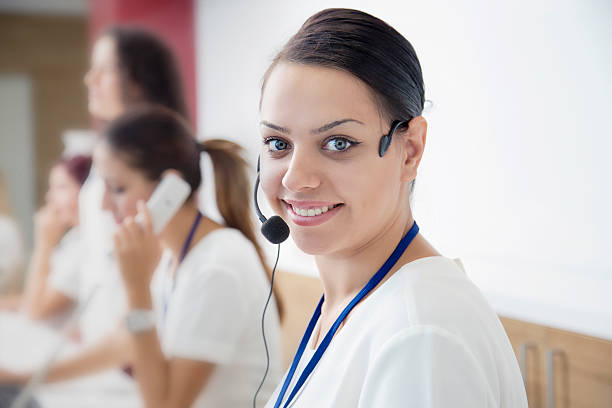 call center in hospital - nurse on phone stock photos and pictures