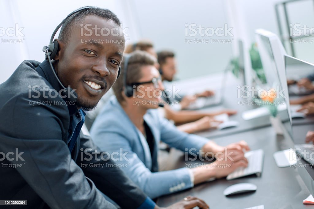 call center operators on the background of the office stock photo