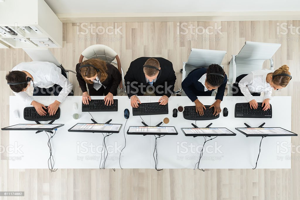 Call Center Operators Working In Office stock photo