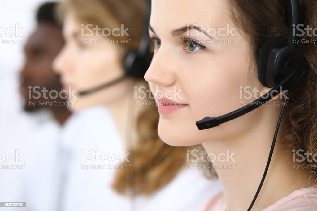 Call center operator.Young beautiful business woman in headset foto stock royalty-free