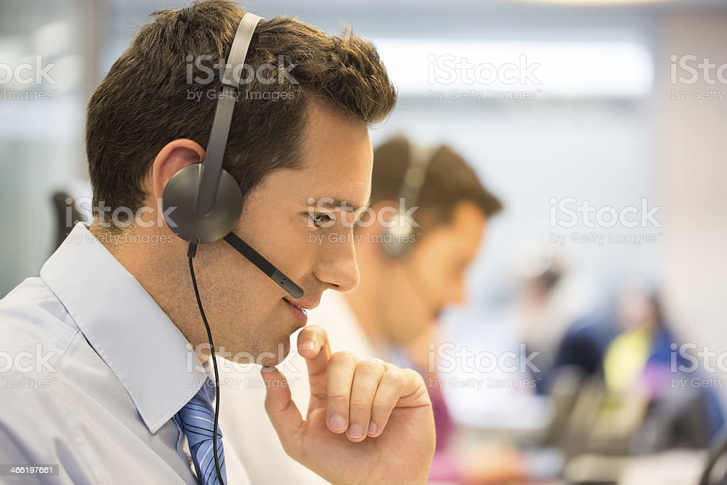 Call center team at office on the phone with headset stock photo