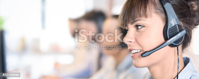 istock Call center worker accompanied by her team. 832105590