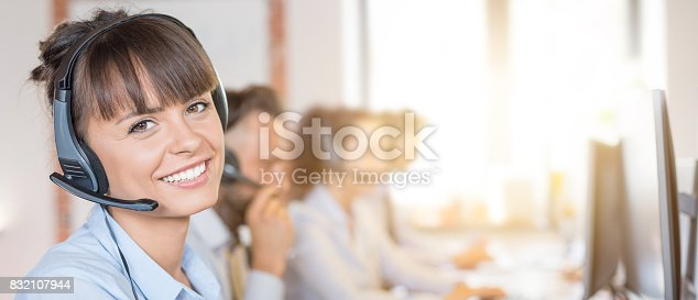 istock Call center worker accompanied by her team. 832107944