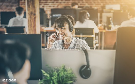 istock Call center worker accompanied by her team. 832109256