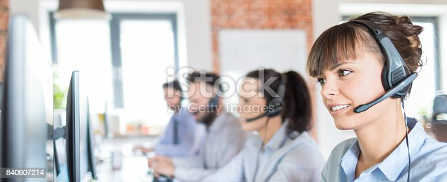istock Call center worker accompanied by her team. 840607214
