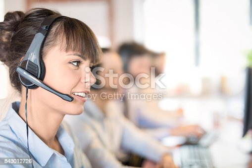 istock Call center worker accompanied by her team. 843012726