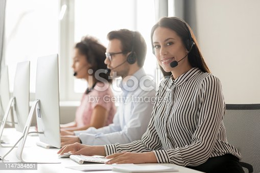 istock Call center worker female working with colleagues looking at camera 1147384851
