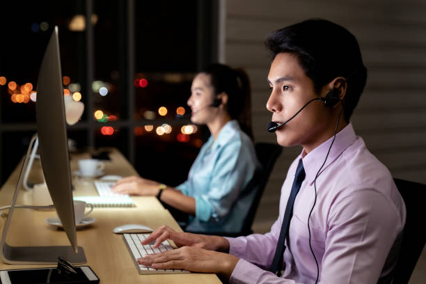 Call Center working hard at night. stock photo